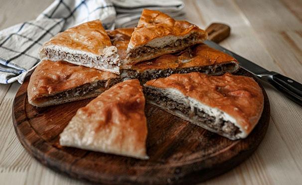 Скидка на Доставка ароматной пиццы и осетинских пирогов от компании «Купи-Пирог». Скидка до 70%