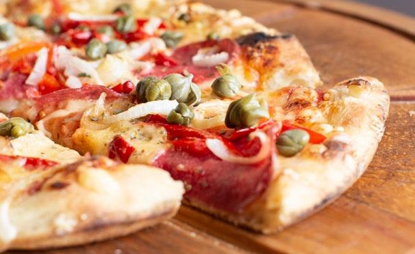 Скидка на Большой выбор вкусной пиццы и осетинских пирогов от пекарни «Пицца Торг». Скидка до 70%